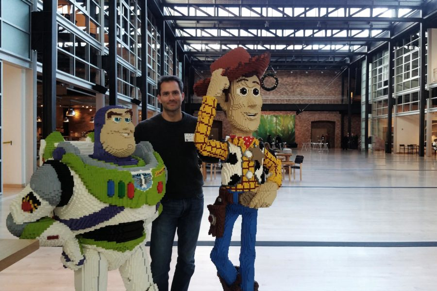 Scott Eaton at Pixar, in atrium with Lego Buzz and Woody